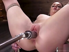 Alluring babe tiedup and fucked by acle harry machine
