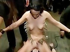 Clamped with clothespins babe on Sybian in public