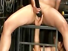 Busty babe finger fucked by girlfriend in cage