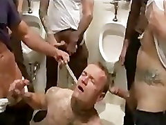 Bound guy cleaning and sucking dicks in rest room
