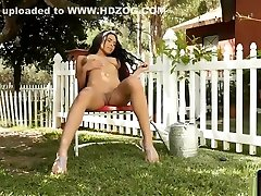 Ebony beauty doing some work in the garden naked