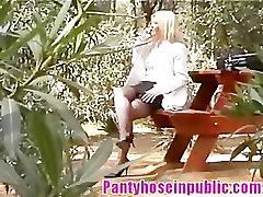 Candid Voyeur Video Of Blonde MILF In Stockings In Public