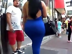 Latina beauty in tight blue dress