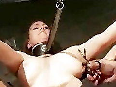 Bound babe with big tits on her back hard flogged