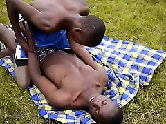 Black twinks enjoy bareback fucking outdoors