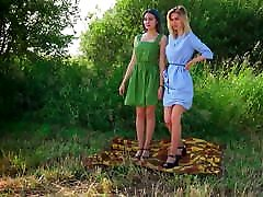 Two Russian tan pantyhose models outdoor photo shoot