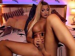 Busty Blonde Tranny Masturbates her Big Cock