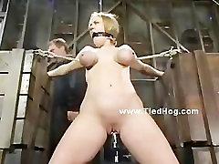 Blonde busty slut tied like a hog in extreme spanking and bondage