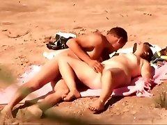 Naughty amateur nudists having sex on the voyeur beach