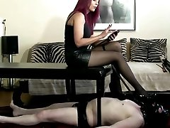 Mistress in sexy agras oile heels, pantyhose and slave