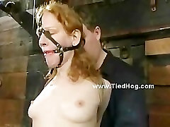 Redhead tied in rope in various positions in bondage punishment v