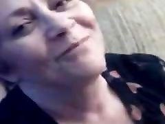 Grandma with glasses giving a blowjob to drink cum
