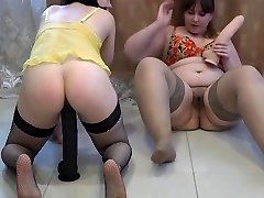 Hairy lesbians with big asses fuck with huge dildos, stretching fat pussies.