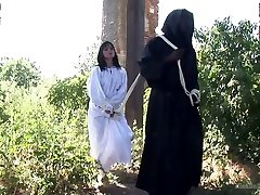 two monks in black suits spanks juicy ass of tied up brunette renata