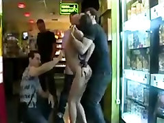 Bound babe fucked and mouth cummed in porn video store