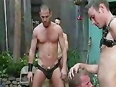 Chained gay seduced in backyard by group of gays