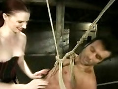 Nasty Domm hanging on her bondaged puppy loves to bring pain