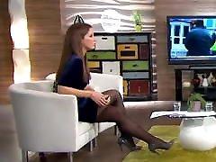 Long legs in black pantyhose on TV 2