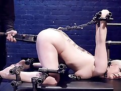 Blonde in strict device bondage is toyed