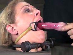 BDSM sub deepthroating toys while gagged