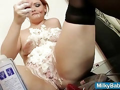 Redhead hottie eats a strawberry then she puts a whip cream all o