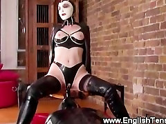 Domina wearing a hood queens her sub