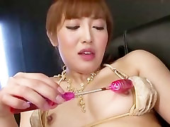 Asian gal Mami gives herself a hard orgasm from the powerful body selecon toys
