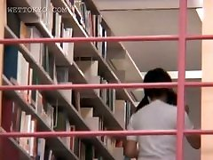 Brunette asian girl seducing her coed in the library