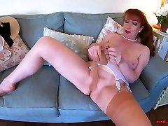 Mature uk girl on top Red stuffs her pantyhose into her pussy