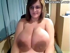 Ugly Chick shows off insanely massive tits