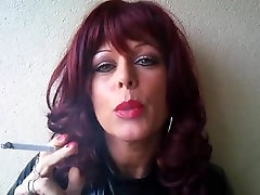 MsR smoking with a red wig outside