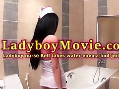Ladyboy kitty wrecks her bucket cunt Bell Takes Water Enema And Jerks Off