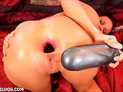 Babe destroying her asshole with a huge silver bullet dildo in HD