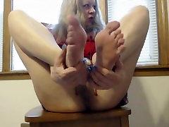 Pair of feet in white high heels