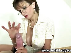 Stockinged mature hoe jerks off cock