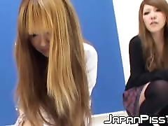Two voluptuous Japanese girls peeing with their clothes on