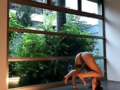 Window public exposure athletic model flexible fitness exercise working out