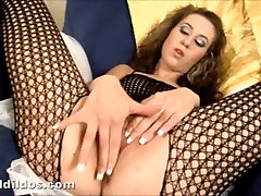 Blonde fucking her shaved pussy with a massive brutal dildo