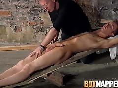 Tied up twink sucked by older master before getting cum shot