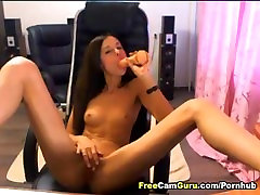 Sexy Babe Sucks her Dildo while Fiddling her Clit