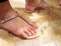 Close up filming Fr&039;s cute liitle feets french pedicured toe