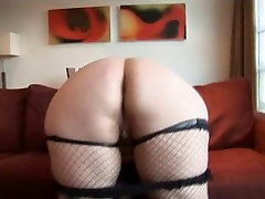 Busty mature BBW in fishnet stockings