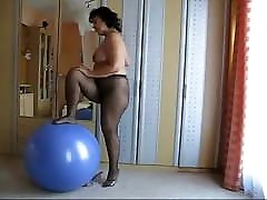 Chubby mature with her ball