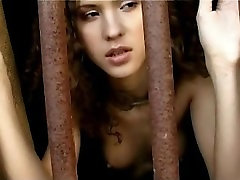 Curly slave immobilized in medieval-stock and punished