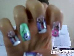 Webcam girl plays with condoms in her pussy, masturbates