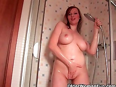 Soccer mom with big tits pushing her hand up her pussy