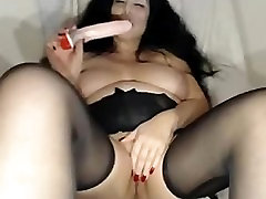 Busty Mature Brunette Stripping And Dildoing