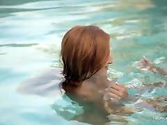 Romantic playful lesbians by the pool