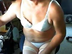 White bearded grandpa in bra and panties playing on princka xxx CD