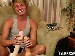 Chained BDSM twink fits huge dildos inside his tight asshole